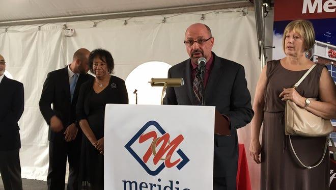 Dover Mayor James P. Dodd at a luxury apartment groundbreaking. On left is Alderwoman Carolyn Blackman.