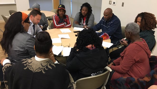 Ross Meyer, interim CEO of the United Way of Greater Cincinnati (left) meets with black community leaders and activists in November at the organization's office on Reading Road in Walnut Hills.