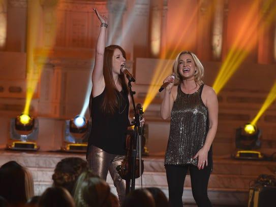 Season 5 finalist Kellie Pickler, right, sings with
