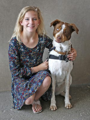 Brystin Fleetwood, 12, poses with her service dog, Gracie, at Riley Hospital for Children at IU Health on Aug. 10, 2016.