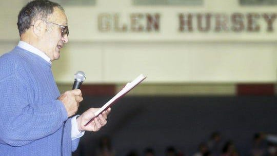 Former Glenford great Glen Hursey speaks during halftime during a 2004 basketball game at Sheridan High School. The school officially named the gymnasium after Hursey that night. He died on Tuesday after a heralded career in athletics and school administration.