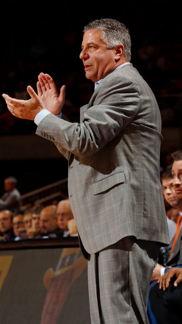 Auburn head coach Bruce Pearl is happy about a play against Tennessee in the first half of their NCAA college basketball game on Tuesday, Jan. 31, 2017 in Auburn, Ala. (Todd J. Van Emst/Opelika-Auburn News via AP)