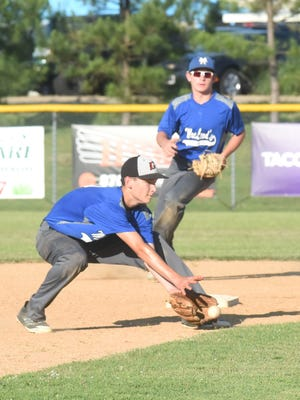 Mountain Home MacLeod shortstop Will Uchtman fields a ground ball as Clayton Jones covers second during Tuesday night action at Cooper Park.