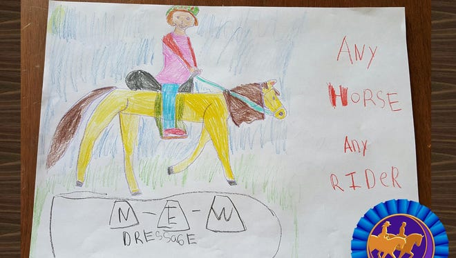 Samantha Bailey, 7, of North Freedom, WI, was the winner of the youth division flyer contest for NEWDA Southern Chapter.