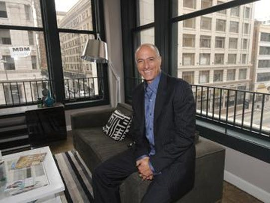 Michael Fallas sat inside an upstairs loft-style apartment