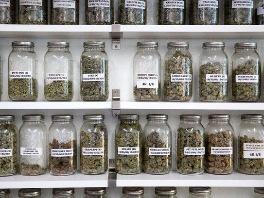 Mason jars with loose marijuana flowers are seen at