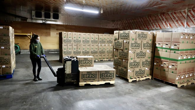 Vanessa Brey, wheels freshly laid and packed eggs into the refrigerated warehouse at Brey's Egg Farm in Bethel. The wholesale business has lost the bulk of its customers to the coronavirus pandemic.