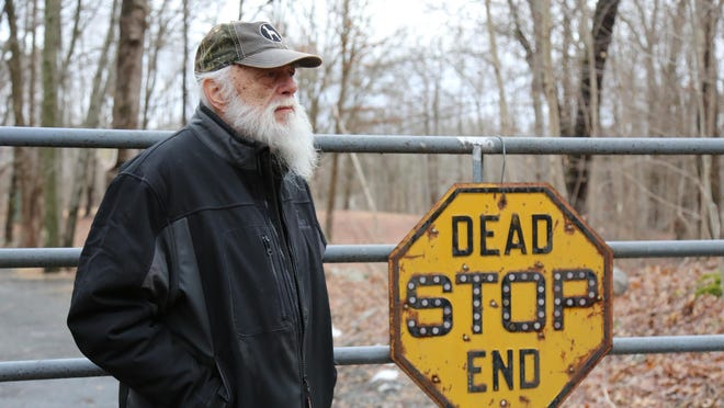 Bob Morgewicz put up a fence and signage on the border of his property and land where a 240,000-square-foot warehouse is proposed in the Town of Montgomery.