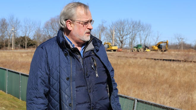 Ronald Eaton, of New Windsor, one of the residents suing to stop the Stewart Hill Industrial Park project, looks at trees that were cut down on the site at Route 207 and Toleman Road.