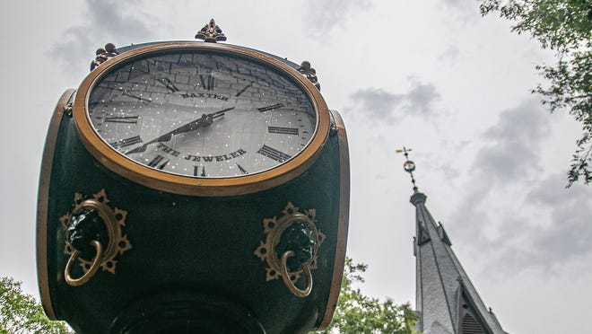 The Baxter Clock face on Pollock Street is spotted with raindrops a few hours before Tropical Storm Isaias arrives.