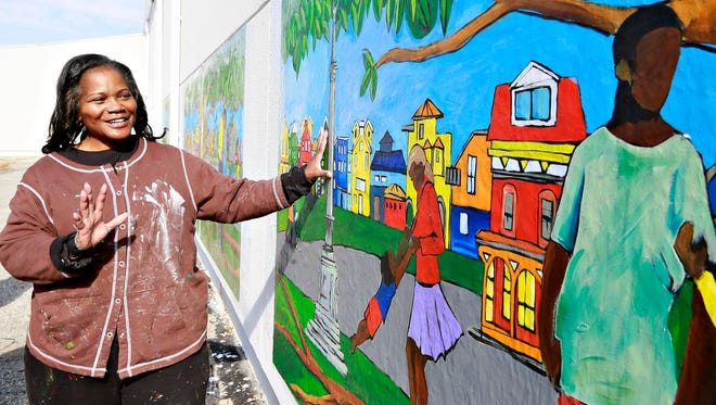 """Artist Ophelia Chambliss, of Manchester Township, talks about the mural """"Community of Color"""" after it is unveiled at Voni Grimes Gym in York City, Thursday, Nov. 2, 2017. Just under 200 community members worked together in painting the project. Additional pieces will be added to the mural when funds have been raised for the adhesive. Dawn J. Sagert photo"""