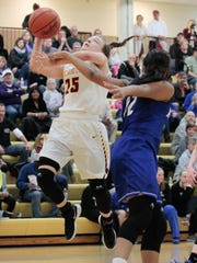 Lexin Fleming of McAuley gets fouled on her way to