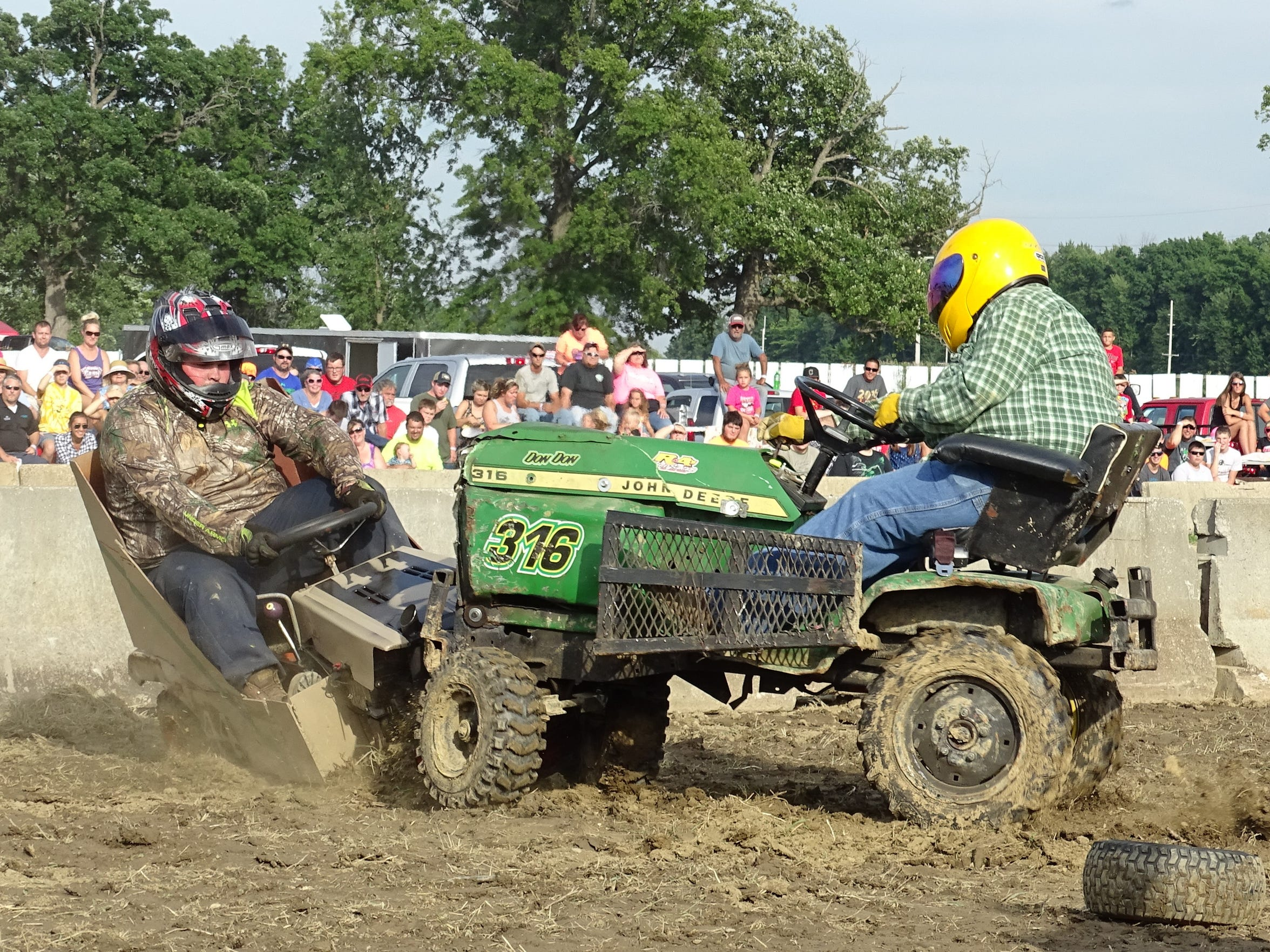 Keith Foor of Marion, left, gets rammed Sunday by Don Walter of Fostoria during the lawn tractor class of the demolition derby at the Crawford County Fair. Walter won the contest.