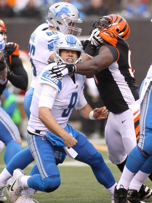 Lions quarterback Matthew Stafford is hit after throwing a pass against the Bengals during the second half of the Lions' 26-17 loss on Sunday, Dec. 24, 2017, in Cincinnati.