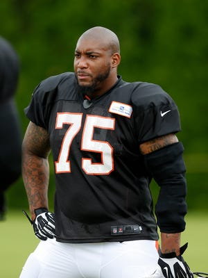 Cincinnati Bengals defensive tackle Devon Still takes a break during training camp downtown.