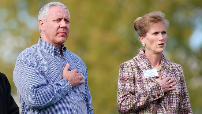 Rep. Ken Buck, R-Colo., stands beside his wife Perry Buck in this file photo.