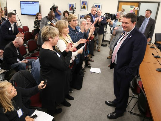 Education Commissioner Stephen Pruitt gets applause from assembled educators while he waits on the board to determine his fate.April 17, 2018