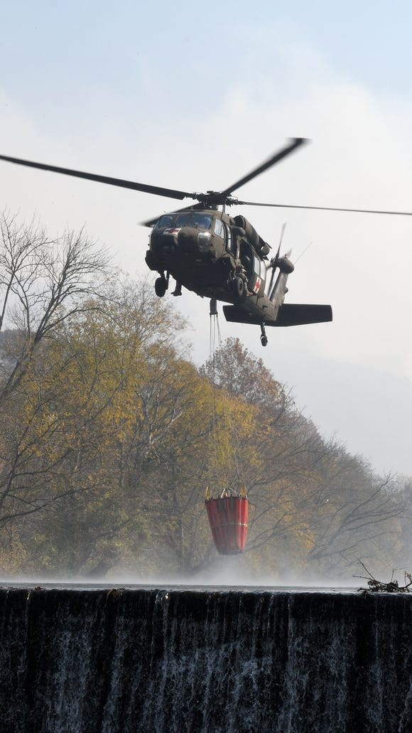 Army National Guard helicopters were getting water