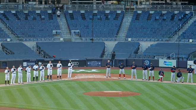 The Yankees, left, and the Red Sox line up for the national anthem before Friday night's game at Yankee Stadium.