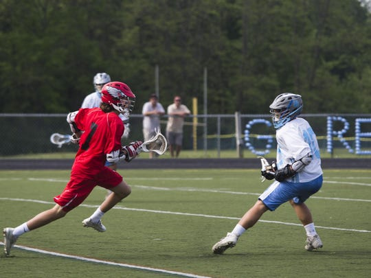CVU midfielder Oliver Masson takes on South Burlington's Calvin Hultgren during the high school boys lacrosse regular-season finale in May. The two teams meet in today's championship game at Burlington High School.
