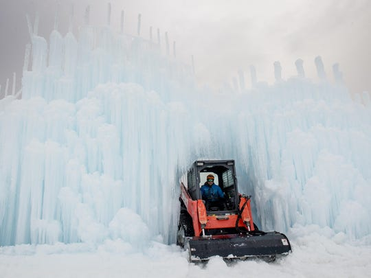 Site manager Al Larsen softens snow and ice using a skidsteer to create a walking path Thursday as the Ice Castles are created at Homestead Resort in Midway, Utah.