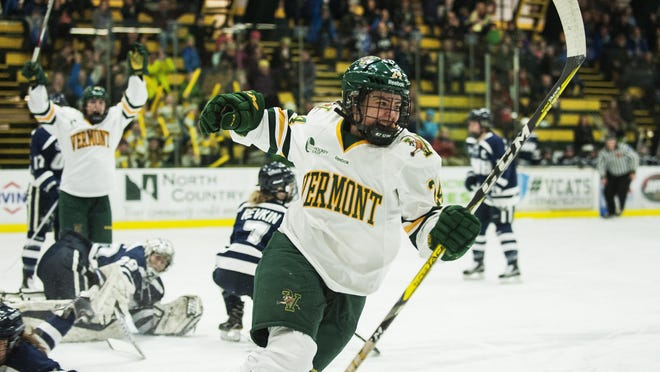 Vermont's Saana Valkama (24) celebrates a goal during the women's hockey game between the New Hampshire Wildcats and the Vermont Catamounts at Gutterson Fieldhouse on Friday night.