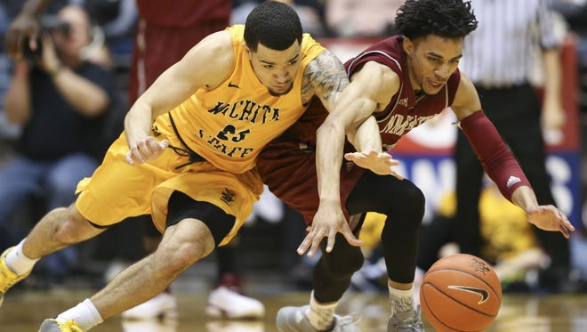 Wichita State's Fred VanVleet, left, and New Mexico State's Matt Taylor battle for the ball during Monday's game at Charles Koch Arena in Wichita, Kan.