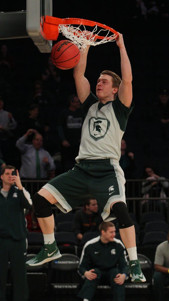 MSU guard Keenan Wetzel (15) dunks the ball during