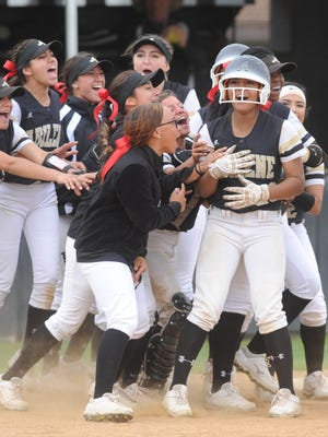 Abilene High player mob Alyssa Washington after her game-winning, RBI triple lifted the Lady Eagles to a 2-1 victory over Keller Fossil Ridge in a District 3-6A game Friday, April 20, 2018 at the AHS softball field.