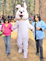 The Easter bunny csays hello to adults enjoying the event.