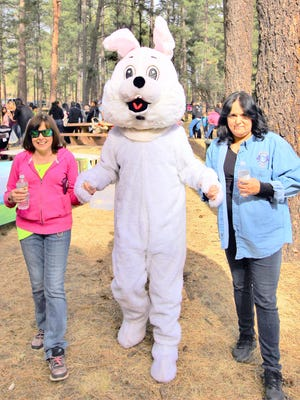 The Easter bunny says hello to adults enjoying the event.