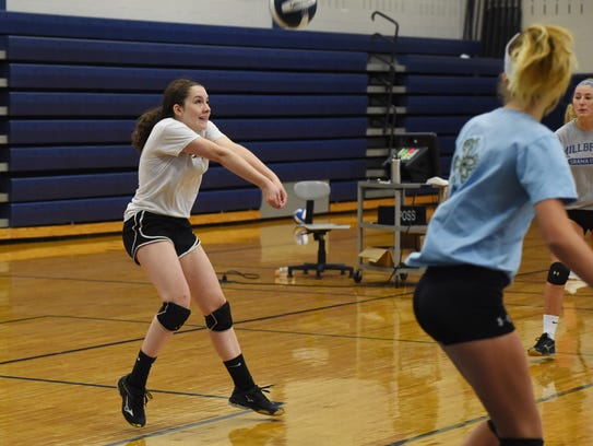 Cecilia Dignan, left, participates in volleyball practice