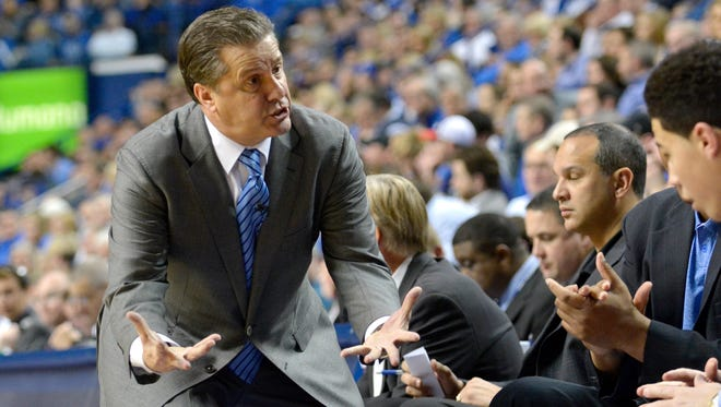 Kentucky Head Coach John Calipari talks to his bench during the second half against Vanderbilt at Rupp Arena in Lexington Tuesday Night. Kentucky won 65-57.