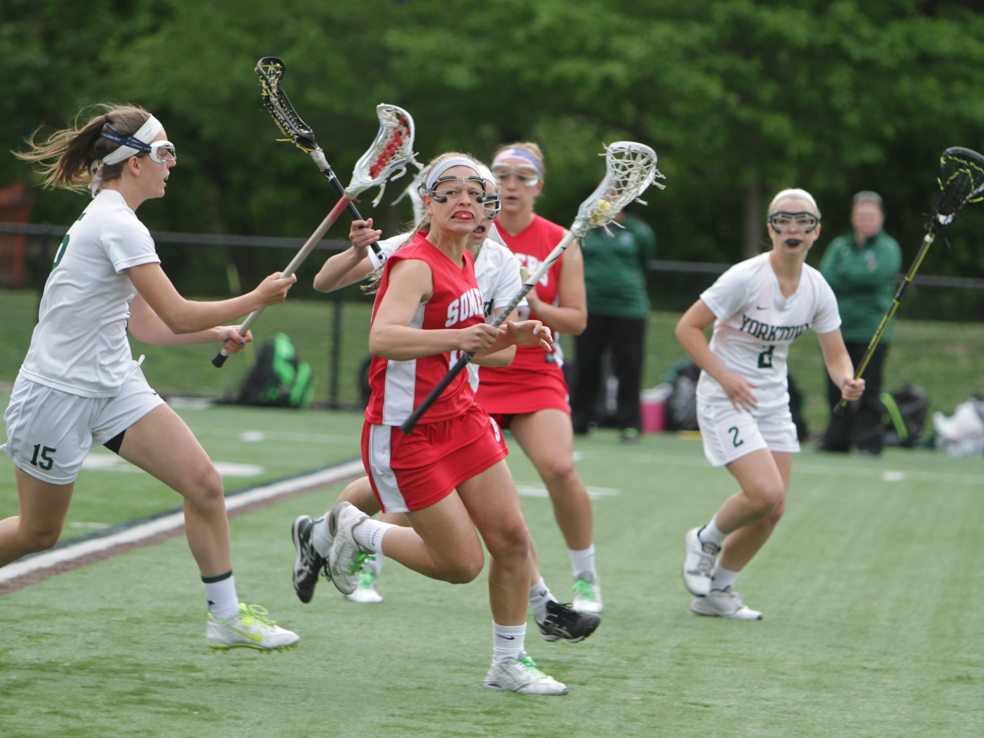 Somers' Izza LaRocca (14) is defended by Yorktown's Ashley Stilo during the Class B final at Torne Valley Stadium. Somers won 10-9.
