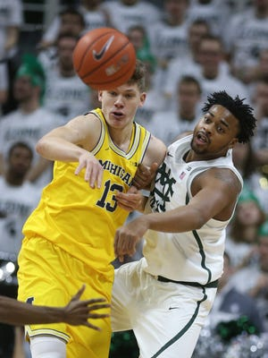 Michigan forward Moritz Wagner is defended by Michigan State forward Nick Ward in the first half Sunday, Jan. 29, 2017 at Breslin Center in East Lansing.