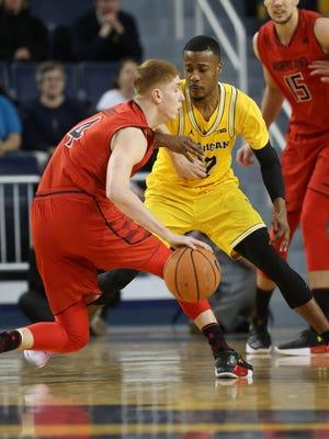 Michigan guard Muhammad-Ali Abdur-Rahkman defends against Maryland guard Kevin Huerter during the first half on Monday, Jan. 15, 2018, at Crisler Center.