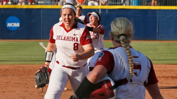 Oklahoma pitcher Paige Parker (8) pumps her fist after closing out the top half of the third inning against Auburn in the deciding game of the championship series of the NCAA softball College World Series, Wednesday, June 8, 2016, in Oklahoma City.(AP Photo/Sue Ogrocki)