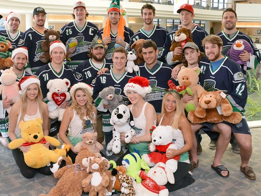 Dancer Melody Lynn participated with the Everblades in their annual teddy bear giveaway.