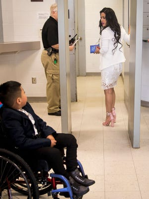 Ricky Solis, 6, of Springdale, Ohio, was not allowed to go through a security check Feb. 8, 2018, at the Morrow County Jail in Mount Gilead, Ohio, north of Columbus to watch his mother, Sandra Mendoza, marry Yancarlos Mendez. Mendez had been his only caregiver besides his mom since car wreck in February 2017 paralyzed him from the waist down.