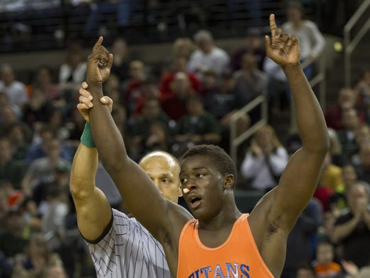 Tyree Sutton of Keansburg celebrates after defeating
