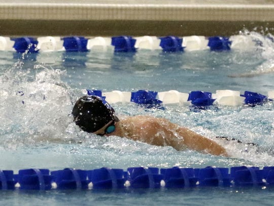 Holton Ike of Horseheads swims to a victory in the
