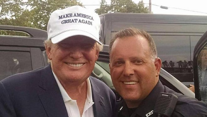 Edison Democratic Chairman Keith Hahn, also a police officer in the township, poses with Republican presidential candidate Donald Trump Sunday during the Barclay's tournament at the Plainfield Country Club.
