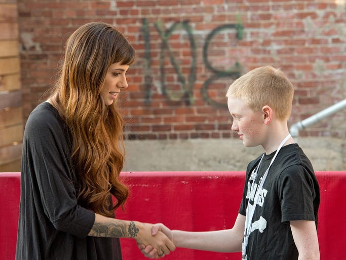 Singer Christina Perri performed at a packed concert at Bogart's. Here, Perri shakes hands with Michael Vickers of Springfield at the meet and greet before the show.