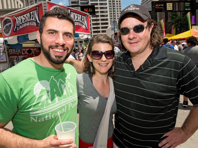 The 36th annual edition of Taste of Cincinnati kicked off Downtown.  Nathan and Glenda Wylder and Bryan Barr of Columbus.