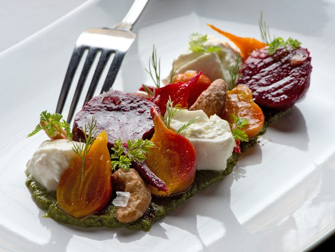 Take a look inside Nando, the new restaurant upstairs from Nuvo in Covington. Wood grilled beets.