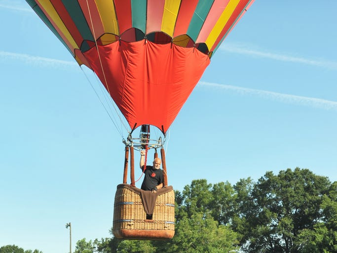 Pilot Mike Hanson of Indianola checks the target Sunday after his competition flight toss during the 28th Annual Mississippi Championship Hot Air Balloon Fest at the Canton Multi-Purpose Complex.