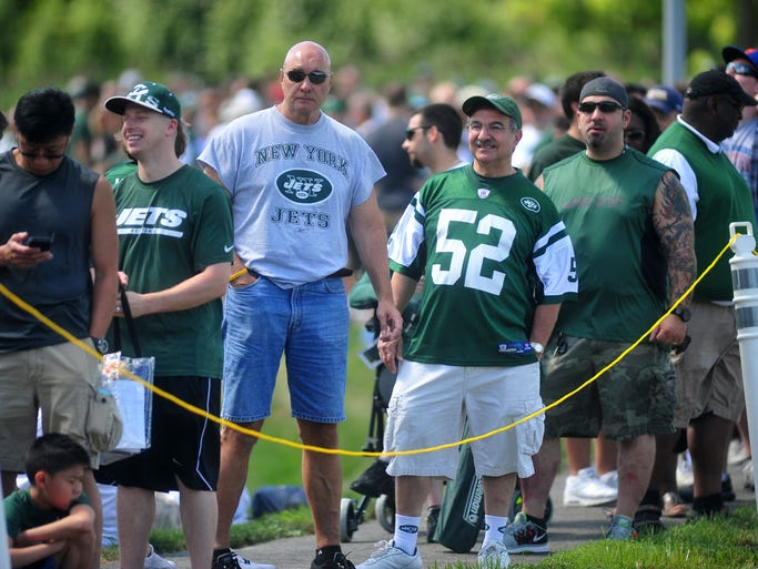 Fans wait in line for entry to the facility. Jets season-ticket holders converge on the team's training facility Monday morning for Jets Fest and to watch the team practice in Florham Park, NJ. Monday, Aug. 18, 2014. Special to the NJ Press Media/Karen Mancinelli/Daily Record MOR 0819 jets practice