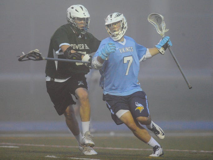 Cape Henlopen attack Luke Benson works against the Tower Hill defense on Friday night in Lewes.