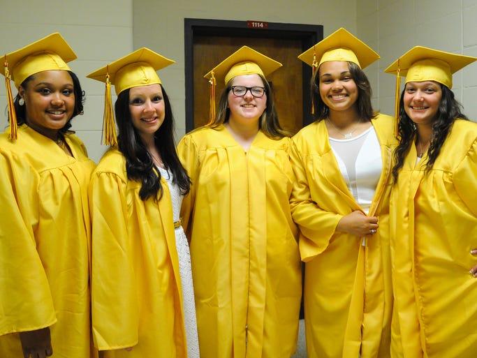 Ti'are Tighman, Lauren McCoy, Amanda Sims, Jalisa Jones, and Tiffany Stevens pose for a photo before Washington High graduation ceremonies on Monday evening at UMES.