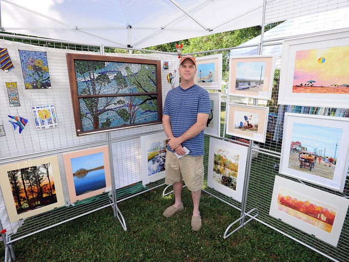 "Jeffery Todd Moore from Dagsboro with his artwork at the Millsboro Art League which held their Inaugural ""Art in the Park"" Show on Saturday June 14th in  Cupola Park in Downtown Millsboro."